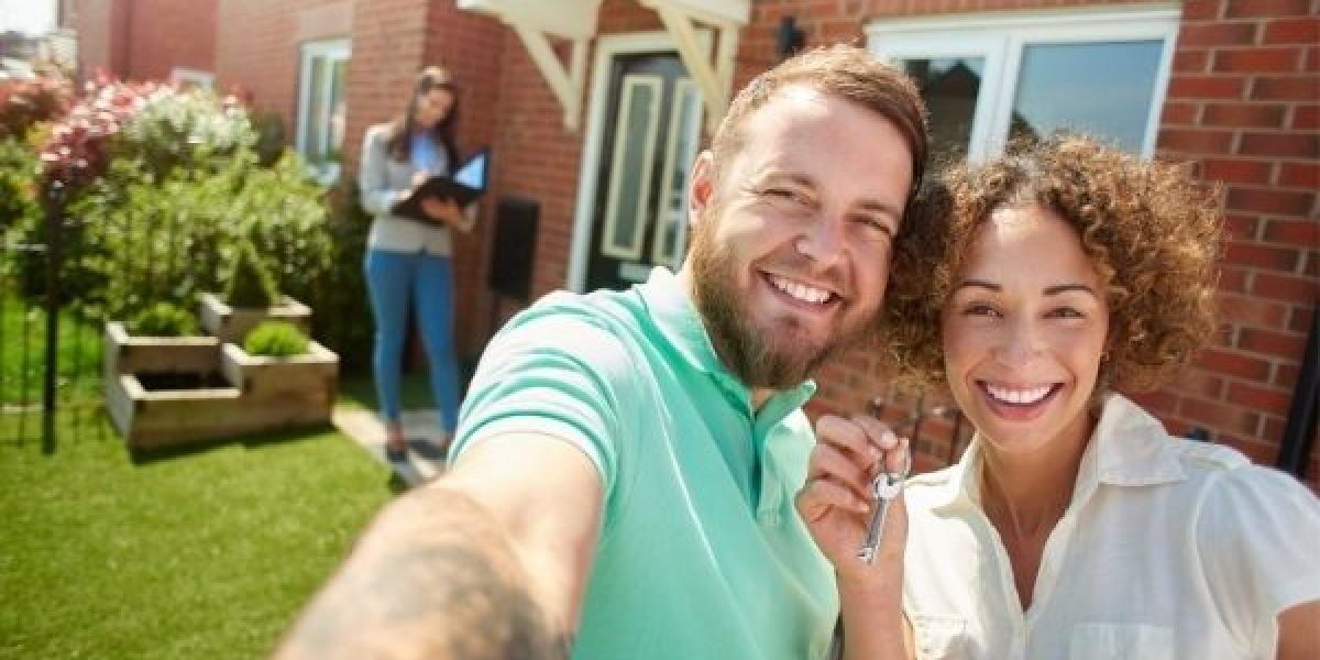 First home buyers in front of their new house